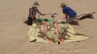 Photo of انطلاق موسم العلاج بالحمام الرملي مع ارتفاع درجات الحرارة في جالو