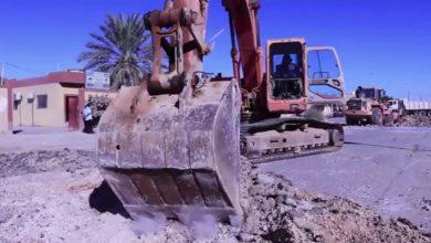 Photo of أعمال صيانة بالطريق الرابط بين وسط المدينة وجامعة بني وليد