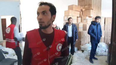 Photo of الهلال الأحمر ببني وليد يوزع مساعدات على الأسر النازحة